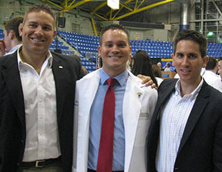 Mark Turczak, BS '12, MHS '14, PA-C  with his brothers, Andrew, left and Alex, right, at Quinnipiac University graduation.