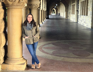 Viki Suslovic, MSID '19, stands on Stanford's campus where she works as an instructional designer.